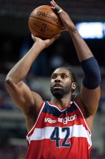 Oct 22, 2013; Auburn Hills, MI, USA; Washington Wizards center Nene (42) shoots a free throw during the second quarter against the Detroit Pistons at The Palace of Auburn Hills. Mandatory Credit: Tim Fuller-USA TODAY Sports