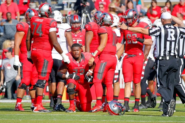 Nov 2, 2013; Piscataway, NJ, USA;  Rutgers Scarlet Knights offensive linesman Kaleb Johnson (72) loses his helmet while recovering a fumble during the first half against the Temple Owls at High Points Solutions Stadium. Mandatory Credit: Jim O'Connor-USA TODAY Sports