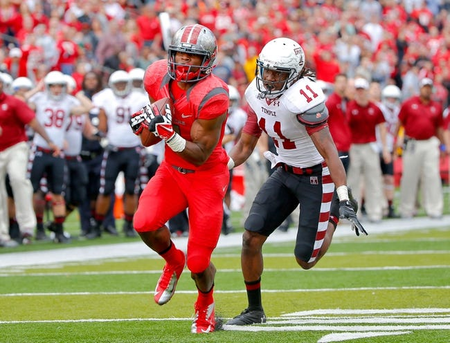 Nov 2, 2013; Piscataway, NJ, USA;  Rutgers Scarlet Knights wide receiver Leonte Carroo (4) scores a touchdown after a pass reception against the Temple Owls at High Points Solutions Stadium. Rutgers Scarlet Knights defeat the Temple Owls 23-20. Mandatory Credit: Jim O'Connor-USA TODAY Sports