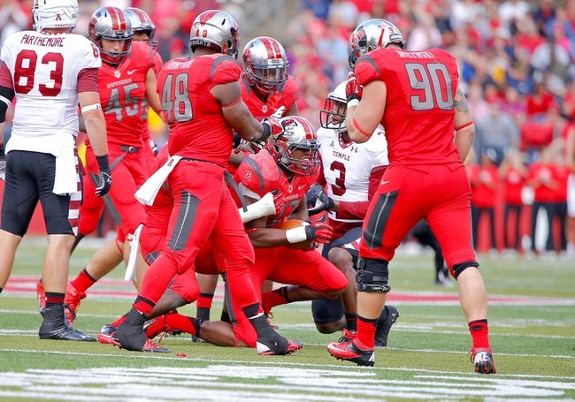 Nov 2, 2013; Piscataway, NJ, USA;  Rutgers Scarlet Knights defensive back Delon Stephenson (27) intercepts a pass during the second half against the Temple Owls at High Points Solutions Stadium. Rutgers Scarlet Knights defeat the Temple Owls 23-20. Mandatory Credit: Jim O'Connor-USA TODAY Sports