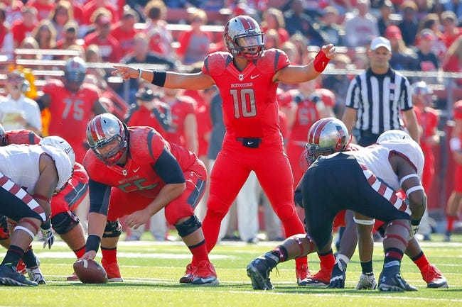 Nov 2, 2013; Piscataway, NJ, USA;  Rutgers Scarlet Knights quarterback Gary Nova (10) audibles during the first half against the Temple Owls at High Points Solutions Stadium. Mandatory Credit: Jim O'Connor-USA TODAY Sports