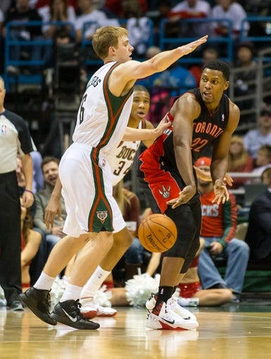Nov 2, 2013; Milwaukee, WI, USA; Toronto Raptors forward Rudy Gay (22) passes the ball around Milwaukee Bucks guard Nate Wolters (6) during the game at BMO Harris Bradley Center. Toronto won 97-90.  Mandatory Credit: Jeff Hanisch-USA TODAY Sports