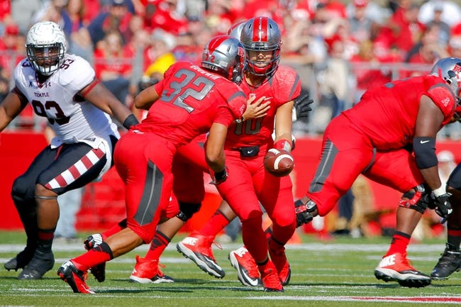 Nov 2, 2013; Piscataway, NJ, USA;  Rutgers Scarlet Knights quarterback Gary Nova (10) hands off to running back Justin Goodwin (32) during the first half against the Temple Owls at High Points Solutions Stadium. Mandatory Credit: Jim O'Connor-USA TODAY Sports