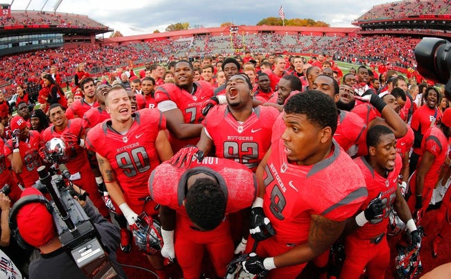 Nov 2, 2013; Piscataway, NJ, USA;  Rutgers Scarlet Knights celebrate a 23-20 victory over the Temple Owls at High Points Solutions Stadium. Mandatory Credit: Jim O'Connor-USA TODAY Sports