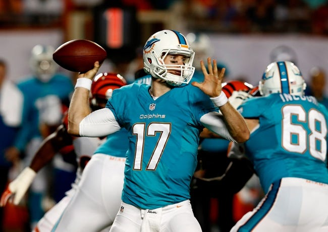 Oct 31, 2013; Miami Gardens, FL, USA;  Miami Dolphins quarterback Ryan Tannehill (17) drops back to pass in the first quarter of a game against the Cincinnati Bengals at Sun Life Stadium. Mandatory Credit: Robert Mayer-USA TODAY Sports