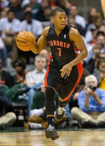 Nov 2, 2013; Milwaukee, WI, USA; Toronto Raptors guard Kyle Lowry (7) during the game against the Milwaukee Bucks at BMO Harris Bradley Center. Toronto won 97-90.  Mandatory Credit: Jeff Hanisch-USA TODAY Sports