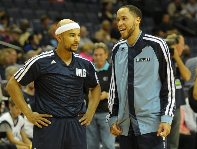 Nov 1, 2013; Memphis, TN, USA; Memphis Grizzlies point guard Jerryd Bayless (7) and small forward Tayshaun Prince (21) talk before the game against Detroit Pistons at FedExForum. Memphis Grizzlies beat the Detroit Pistons 111 - 108. Mandatory Credit: Justin Ford-USA TODAY Sports