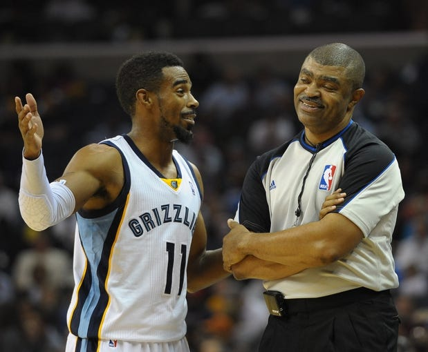 Nov 1, 2013; Memphis, TN, USA; Memphis Grizzlies point guard Mike Conley (11) and referee Tony Brown (6) talk during a time out against Detroit Pistons at FedExForum. Memphis Grizzlies beat the Detroit Pistons 111 - 108. Mandatory Credit: Justin Ford-USA TODAY Sports