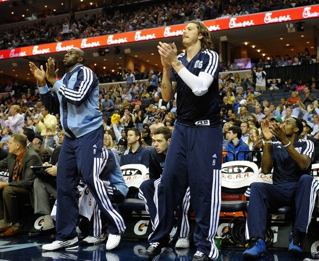 Nov 1, 2013; Memphis, TN, USA; Memphis Grizzlies small forward Quincy Pondexter (20) and small forward Mike Miller (13) cheer for their teammates during the game against Detroit Pistons at FedExForum. Memphis Grizzlies beat the Detroit Pistons 111 - 108. Mandatory Credit: Justin Ford-USA TODAY Sports