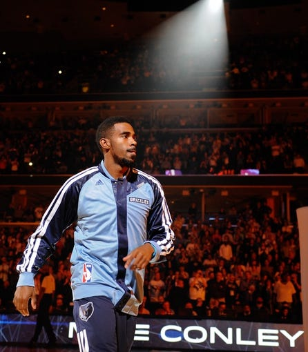 Nov 1, 2013; Memphis, TN, USA; Memphis Grizzlies point guard Mike Conley (11) before the game against Detroit Pistons at FedExForum. Memphis Grizzlies beat the Detroit Pistons 111 - 108. Mandatory Credit: Justin Ford-USA TODAY Sports