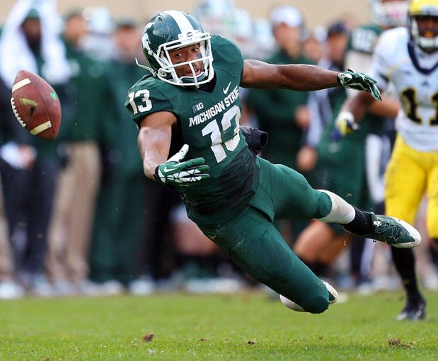 Nov 2, 2013; East Lansing, MI, USA; Michigan State Spartans wide receiver Bennie Fowler (13) drops the pass during the 2nd half of a game against the Michigan Wolverines at Spartan Stadium. MSU won 29-6. Mandatory Credit: Mike Carter-USA TODAY Sports