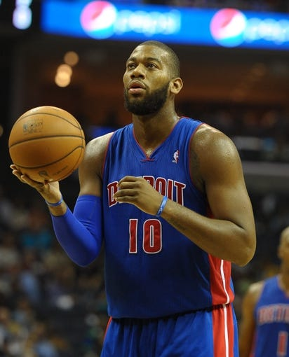 Nov 1, 2013; Memphis, TN, USA; Detroit Pistons center Greg Monroe (10) shoots a free throw against Memphis Grizzlies at FedExForum. Memphis Grizzlies beat the Detroit Pistons 111 - 108. Mandatory Credit: Justin Ford-USA TODAY Sports