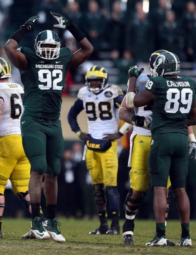 Nov 2, 2013; East Lansing, MI, USA; Michigan State Spartans defensive end Joel Heath (92) reacts to a play during the 2nd half of a game against the Michigan Wolverines at Spartan Stadium. MSU won 29-6. Mandatory Credit: Mike Carter-USA TODAY Sports