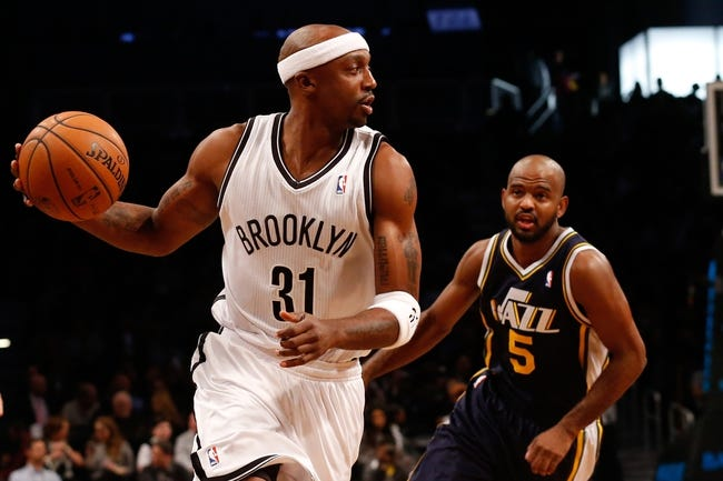 Nov 5, 2013; Brooklyn, NY, USA; Brooklyn Nets shooting guard Jason Terry (31) advances the ball as Utah Jazz point guard John Lucas III (5) defends during the first quarter at Barclays Center. Mandatory Credit: Anthony Gruppuso-USA TODAY Sports