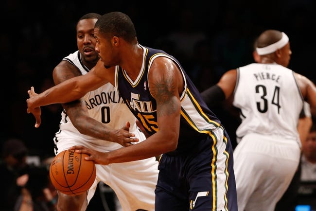 Nov 5, 2013; Brooklyn, NY, USA; Utah Jazz power forward Derrick Favors (15) dribbles against Brooklyn Nets center Andray Blatche (0) during the first quarter at Barclays Center. Mandatory Credit: Anthony Gruppuso-USA TODAY Sports