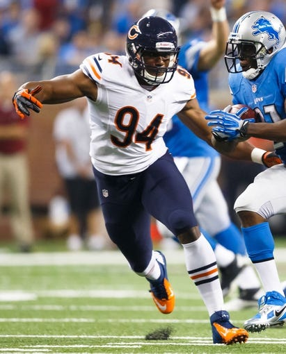 Sep 29, 2013; Detroit, MI, USA; Chicago Bears defensive end Cornelius Washington (94) in the second quarter against the Detroit Lions at Ford Field. Mandatory Credit: Rick Osentoski-USA TODAY Sports