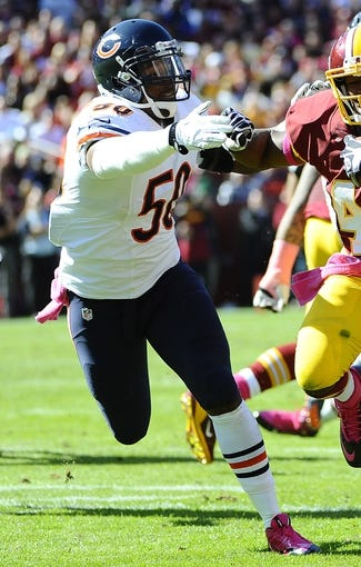 Oct 20, 2013; Landover, MD, USA; Chicago Bears linebacker James Anderson (50) chases during the first half against the Washington Redskins at FedEX Field. Mandatory Credit: Brad Mills-USA TODAY Sports