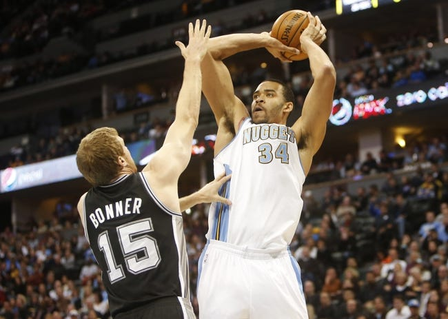Nov 5, 2013; Denver, CO, USA; Denver Nuggets center JaVale McGee (34) shoots the ball over San Antonio Spurs center Matt Bonner (15) during the first half at Pepsi Center. Mandatory Credit: Chris Humphreys-USA TODAY Sports