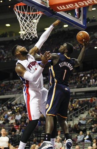Nov 5, 2013; Auburn Hills, MI, USA; Indiana Pacers shooting guard Lance Stephenson (1) attempts a shot defended by Detroit Pistons center Andre Drummond (0) during the third quarter at The Palace of Auburn Hills. The Pacers beat the Pistons 99-91. Mandatory Credit: Raj Mehta-USA TODAY Sports