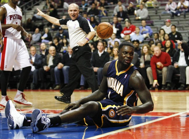 Nov 5, 2013; Auburn Hills, MI, USA; Indiana Pacers shooting guard Lance Stephenson (1) gets knocked to the ground during the third quarter against the Detroit Pistons at The Palace of Auburn Hills. The Pacers beat the Pistons 99-91. Mandatory Credit: Raj Mehta-USA TODAY Sports