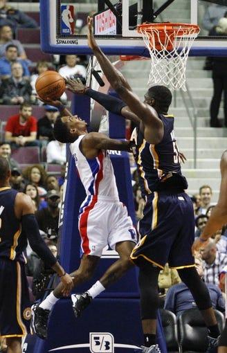 Nov 5, 2013; Auburn Hills, MI, USA; Detroit Pistons point guard Brandon Jennings (7) is defended by Indiana Pacers center Roy Hibbert (55) during the third quarter at The Palace of Auburn Hills. The Pacers beat the Pistons 99-91. Mandatory Credit: Raj Mehta-USA TODAY Sports