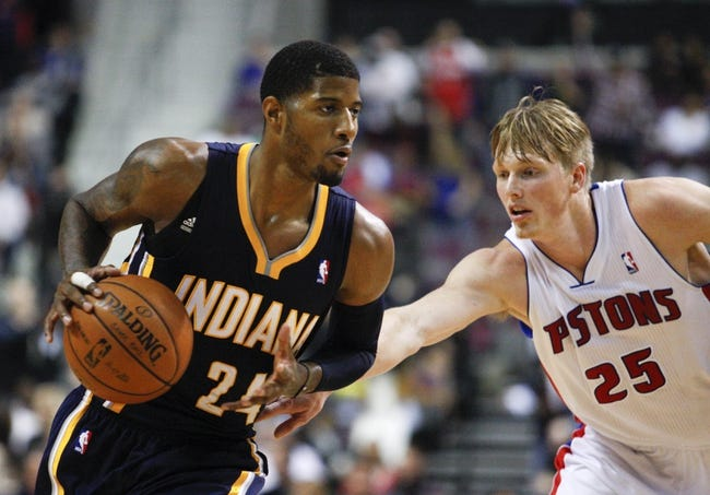 Nov 5, 2013; Auburn Hills, MI, USA; Indiana Pacers small forward Paul George (24) is defended by Detroit Pistons small forward Kyle Singler (25) during the third quarter at The Palace of Auburn Hills. The Pacers beat the Pistons 99-91. Mandatory Credit: Raj Mehta-USA TODAY Sports