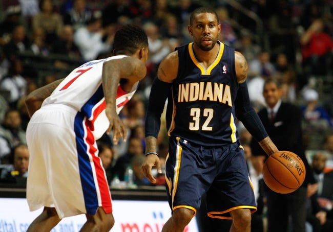 Nov 5, 2013; Auburn Hills, MI, USA; Indiana Pacers point guard C.J. Watson (32) is defended by Detroit Pistons point guard Brandon Jennings (7) during the third fourth quarter at The Palace of Auburn Hills. The Pacers beat the Pistons 99-91. Mandatory Credit: Raj Mehta-USA TODAY Sports
