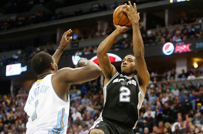 Nov 5, 2013; Denver, CO, USA; San Antonio Spurs guard Kawhi Leonard (2) shoots the ball over Denver Nuggets guard Jodan Hamilton (1) during the second half at Pepsi Center. The Spurs won 102-94. Mandatory Credit: Chris Humphreys-USA TODAY Sports