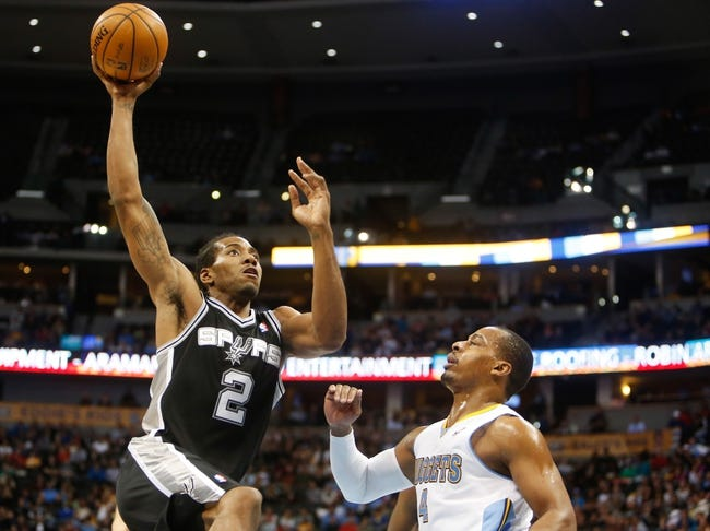 Nov 5, 2013; Denver, CO, USA; San Antonio Spurs forward Kawhi Leonard (2) shoots the ball over Denver Nuggets guard Randy Foye (4)  during the second half at Pepsi Center. The Spurs won 102-94. Mandatory Credit: Chris Humphreys-USA TODAY Sports