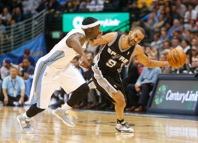Nov 5, 2013; Denver, CO, USA; San Antonio Spurs guard Tony Parker (9) drives the ball against Denver Nuggets guard Ty Lawson (3) during the second half at Pepsi Center. The Spurs won 102-94. Mandatory Credit: Chris Humphreys-USA TODAY Sports