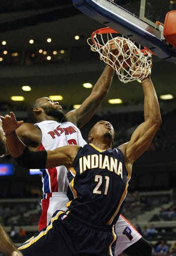 Nov 5, 2013; Auburn Hills, MI, USA; (Editor's Note: Caption Correction) Indiana Pacers power forward David West (21) gets the ball stuck under the rim as he is defended by Detroit Pistons center Greg Monroe (10) during the fourth quarter at The Palace of Auburn Hills. The Pacers beat the Pistons 99-91. Mandatory Credit: Raj Mehta-USA TODAY Sports