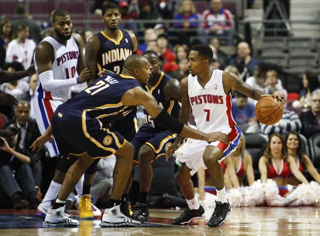 Nov 5, 2013; Auburn Hills, MI, USA; (Editor's Note: Caption Correction) Detroit Pistons point guard Brandon Jennings (7) gets defended by Indiana Pacers power forward David West (21) during the fourth quarter at The Palace of Auburn Hills. The Pacers beat the Pistons 99-91. Mandatory Credit: Raj Mehta-USA TODAY Sports