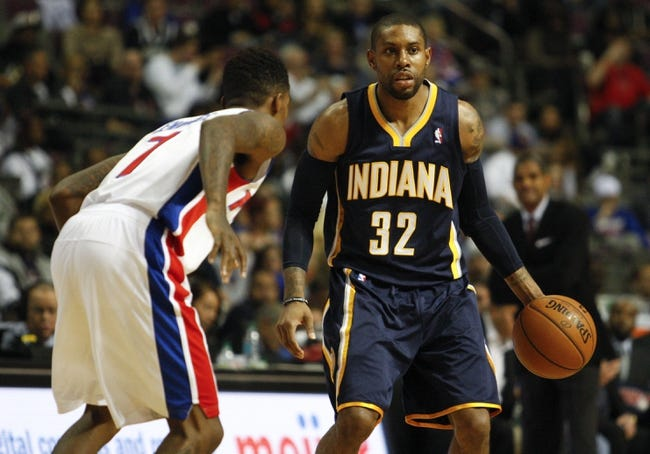 Nov 5, 2013; Auburn Hills, MI, USA; Indiana Pacers point guard C.J. Watson (32) is defended by Detroit Pistons point guard Brandon Jennings (7) during the fourth quarter at The Palace of Auburn Hills. The Pacers beat the Pistons 99-91. Mandatory Credit: Raj Mehta-USA TODAY Sports