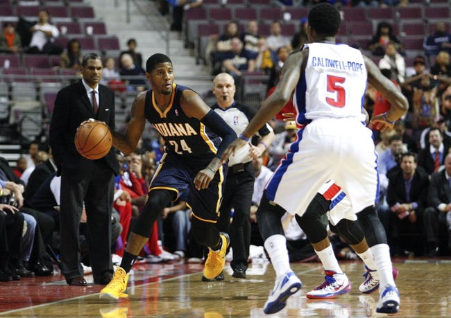Nov 5, 2013; Auburn Hills, MI, USA; Indiana Pacers small forward Paul George (24) is defended by Detroit Pistons shooting guard Kentavious Caldwell-Pope (5) during the fourth quarter at The Palace of Auburn Hills. The Pacers beat the Pistons 99-91. Mandatory Credit: Raj Mehta-USA TODAY Sports