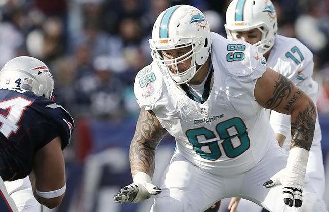 Oct 27, 2013; Foxborough, MA, USA; Miami Dolphins guard Richie Incognito (68) prepares to block against the New England Patriots during the second quarter at Gillette Stadium. Mandatory Credit: Winslow Townson-USA TODAY Sports