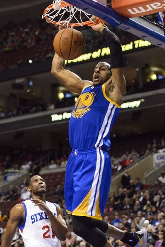 Nov 4, 2013; Philadelphia, PA, USA; Golden State Warriors guard Andre Iguodala (9) dunks during the first quarter against the Philadelphia 76ers at Wells Fargo Center. The Warriors defeated the Sixers 110-90. Mandatory Credit: Howard Smith-USA TODAY Sports