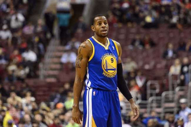 Nov 4, 2013; Philadelphia, PA, USA; Golden State Warriors guard Andre Iguodala (9) during the first quarter against the Philadelphia 76ers at Wells Fargo Center. The Warriors defeated the Sixers 110-90. Mandatory Credit: Howard Smith-USA TODAY Sports