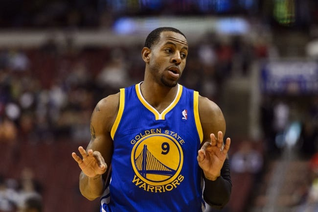 Nov 4, 2013; Philadelphia, PA, USA; Golden State Warriors guard Andre Iguodala (9) celebrates hitting a three point shot during the second quarter against the Philadelphia 76ers at Wells Fargo Center. The Warriors defeated the Sixers 110-90. Mandatory Credit: Howard Smith-USA TODAY Sports