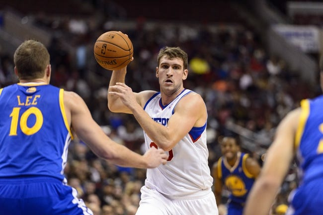 Nov 4, 2013; Philadelphia, PA, USA; Philadelphia 76ers center Spencer Hawes (00) looks to pass during the second quarter against the Golden State Warriors at Wells Fargo Center. The Warriors defeated the Sixers 110-90. Mandatory Credit: Howard Smith-USA TODAY Sports
