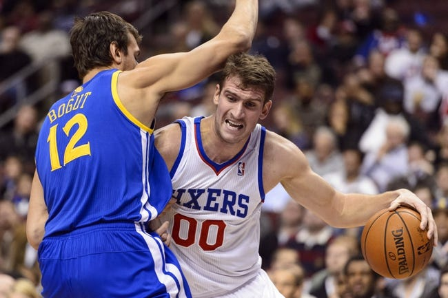 Nov 4, 2013; Philadelphia, PA, USA; Philadelphia 76ers center Spencer Hawes (00) is defended by Golden State Warriors center Andrew Bogut (12) during the third quarter at Wells Fargo Center. The Warriors defeated the Sixers 110-90. Mandatory Credit: Howard Smith-USA TODAY Sports