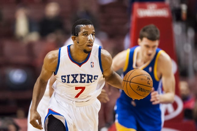 Nov 4, 2013; Philadelphia, PA, USA; Philadelphia 76ers guard Darius Morris (7) brings the ball up court during the fourth quarter against the Golden State Warriors at Wells Fargo Center. The Warriors defeated the Sixers 110-90. Mandatory Credit: Howard Smith-USA TODAY Sports