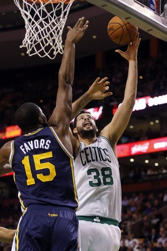 Nov 6, 2013; Boston, MA, USA; Boston Celtics center Vitor Faverani (38) shoots against Utah Jazz power forward Derrick Favors (15) in the first quarter at TD Garden. Mandatory Credit: David Butler II-USA TODAY Sports