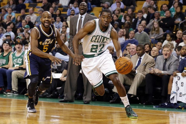 Nov 6, 2013; Boston, MA, USA; Boston Celtics shooting guard Jordan Crawford (27) drives the ball against Utah Jazz point guard John Lucas III (5) in the first quarter at TD Garden. Mandatory Credit: David Butler II-USA TODAY Sports