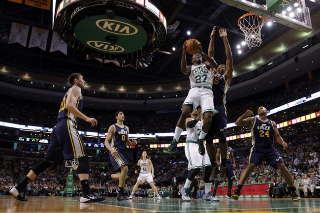 Nov 6, 2013; Boston, MA, USA; Boston Celtics shooting guard Jordan Crawford (27) shoots against Utah Jazz power forward Derrick Favors (15) in the first quarter at TD Garden. Mandatory Credit: David Butler II-USA TODAY Sports