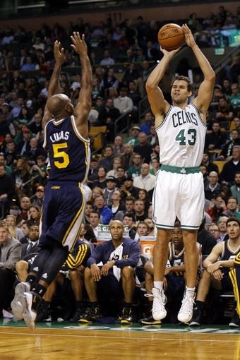 Nov 6, 2013; Boston, MA, USA; Boston Celtics power forward Kris Humphries (43) shoots against Utah Jazz point guard John Lucas III (5) in the first quarter at TD Garden. Mandatory Credit: David Butler II-USA TODAY Sports