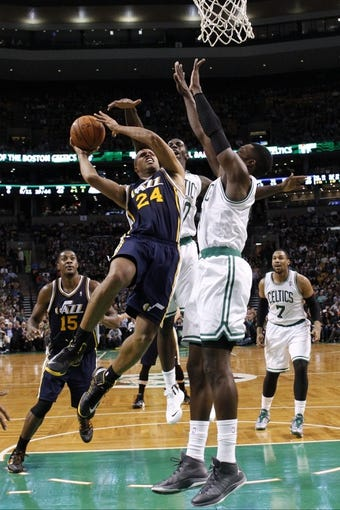 Nov 6, 2013; Boston, MA, USA; Utah Jazz small forward Richard Jefferson (24) drives the ball against Boston Celtics power forward Jeff Green (8) and power forward Brandon Bass (30) in the first quarter at TD Garden. Mandatory Credit: David Butler II-USA TODAY Sports