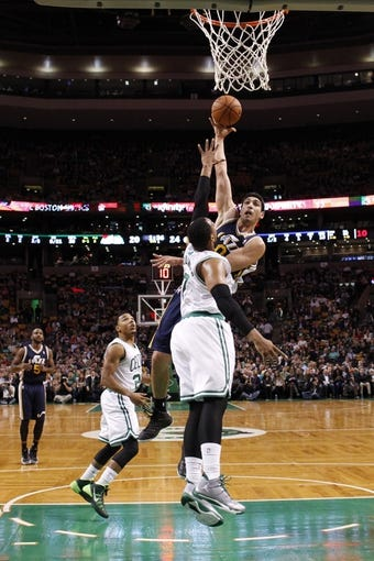 Nov 6, 2013; Boston, MA, USA; Utah Jazz center Enes Kanter (0) shoots against Boston Celtics power forward Jared Sullinger (7) in the first half at TD Garden. Mandatory Credit: David Butler II-USA TODAY Sports