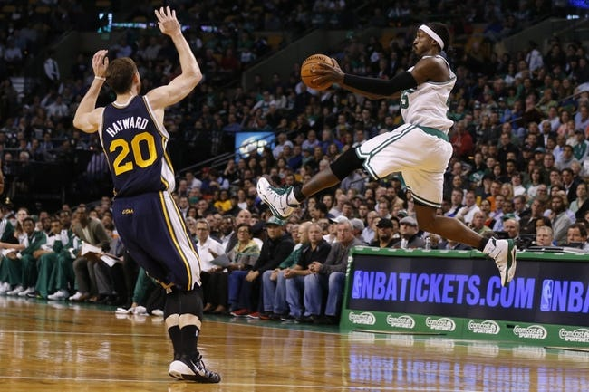 Nov 6, 2013; Boston, MA, USA; Boston Celtics small forward Gerald Wallace (45) looks to pass against Utah Jazz small forward Gordon Hayward (20) in the first half at TD Garden. Mandatory Credit: David Butler II-USA TODAY Sports