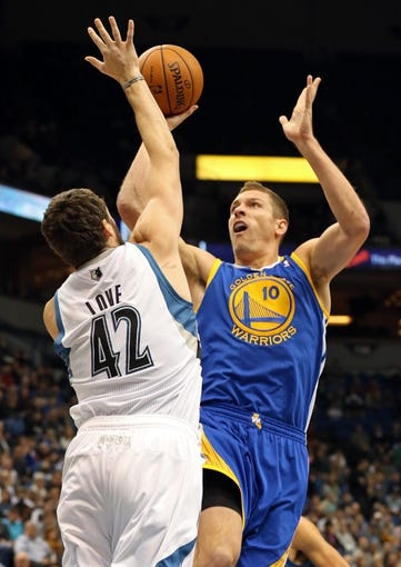 Nov 6, 2013; Minneapolis, MN, USA; Golden State Warriors power forward David Lee (10) goes up for a shot over Minnesota Timberwolves power forward Kevin Love (42) in the first half at Target Center. Mandatory Credit: Jesse Johnson-USA TODAY Sports