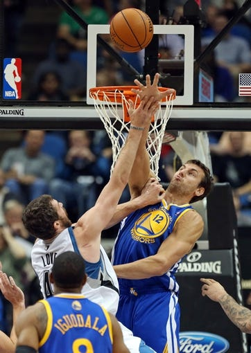 Nov 6, 2013; Minneapolis, MN, USA; Minnesota Timberwolves power forward Kevin Love (42) goes up for a layup as Golden State Warriors center Andrew Bogut (12) attempts to block the shot in the first half at Target Center. Mandatory Credit: Jesse Johnson-USA TODAY Sports